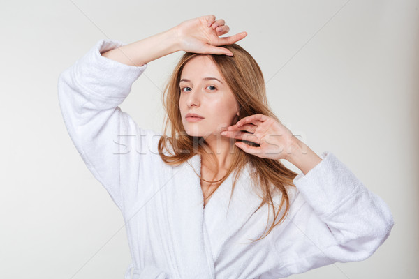 Beauty portrait of a young woman in bathrobe Stock photo © deandrobot