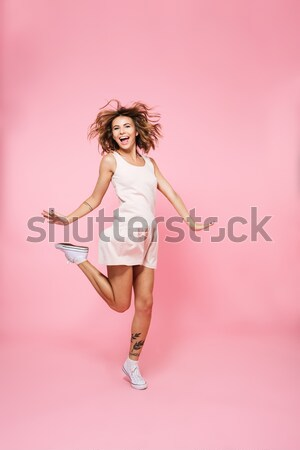 Full length portrait of a cheerful woman in bodysuit Stock photo © deandrobot