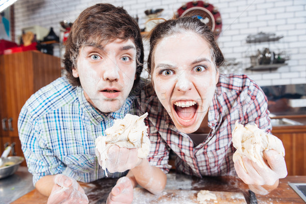 Komiczny zły para mąka twarze Zdjęcia stock © deandrobot