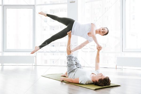Vonzó nő nyújtás jóga partner stúdió lány Stock fotó © deandrobot