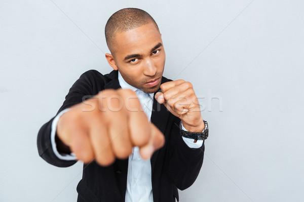 öfkeli genç işadamı ayakta boksör pozisyon Stok fotoğraf © deandrobot