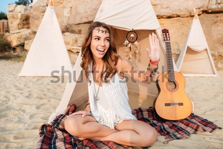 Sorridente jovem hippie mulher posando guitarra Foto stock © deandrobot