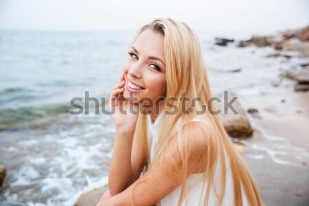 Femme séance roches mer séduisant Photo stock © deandrobot