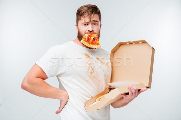 Grappig bebaarde man pizza slice mond naar Stockfoto © deandrobot