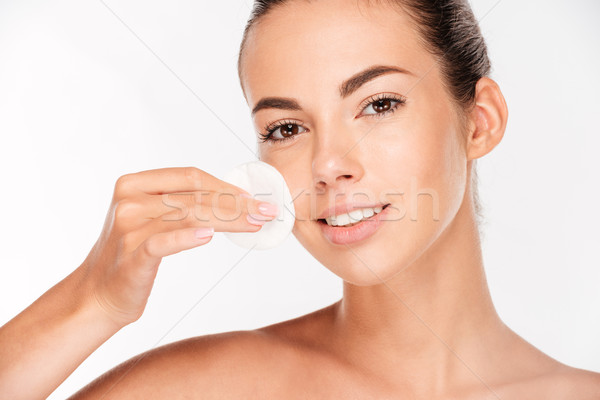 Skin care woman removing face makeup with cotton swab pad Stock photo © deandrobot