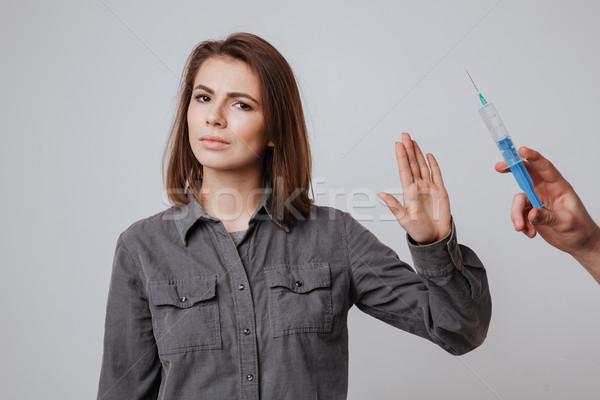 Młodych atrakcyjny pani stop gest Zdjęcia stock © deandrobot