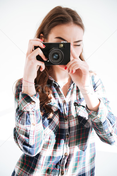 Photographer holding camera Stock photo © deandrobot