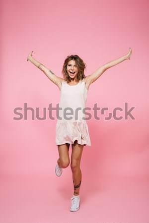 Teljes alakos derűs kislány ugrik levegő örömteli Stock fotó © deandrobot