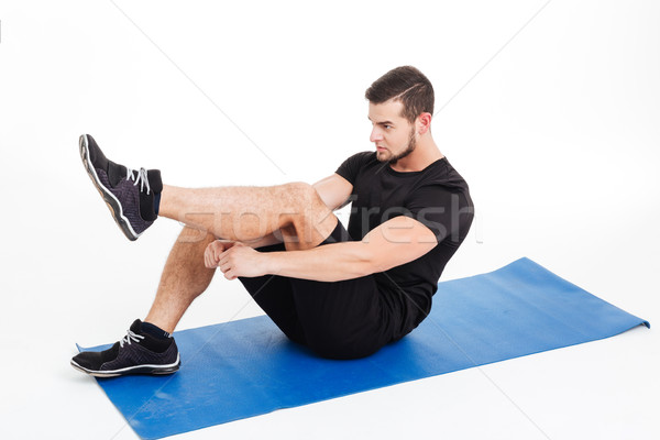 Athletic man shakes press Stock photo © deandrobot