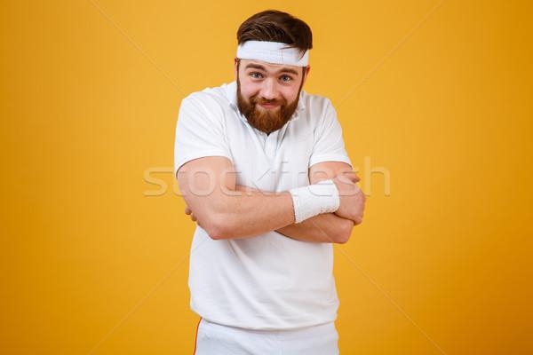 Funny bärtigen Sportler Arme schauen Kamera Stock foto © deandrobot