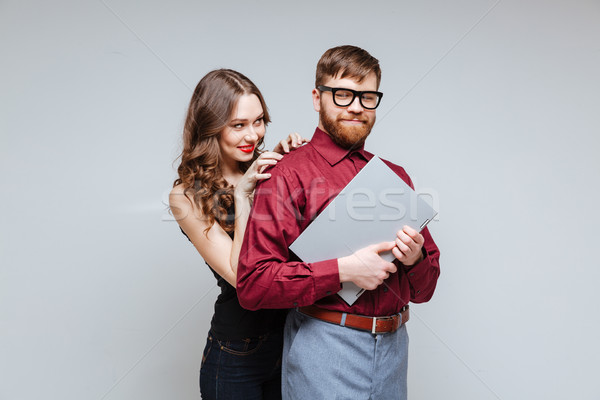 Playful Woman from back of Male nerd Stock photo © deandrobot