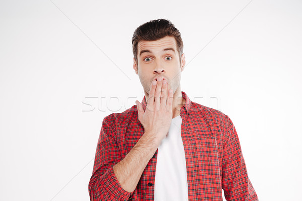 Shocked man covering his mouth Stock photo © deandrobot
