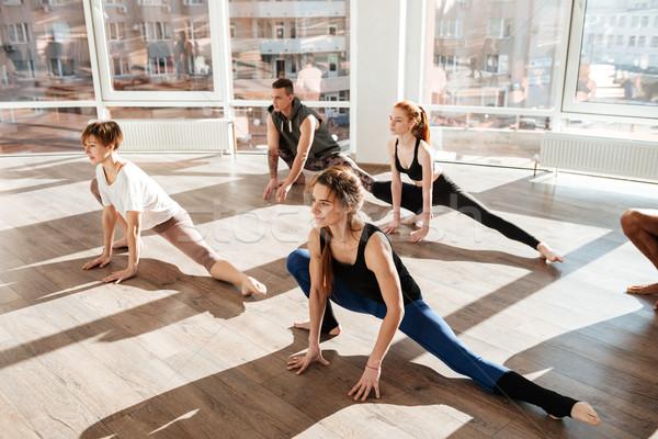 Grup insanlar bacaklar yoga stüdyo Stok fotoğraf © deandrobot