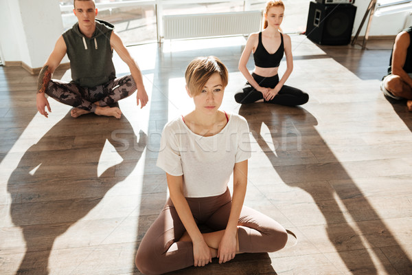 Group of people meditating and doing yoga Stock photo © deandrobot