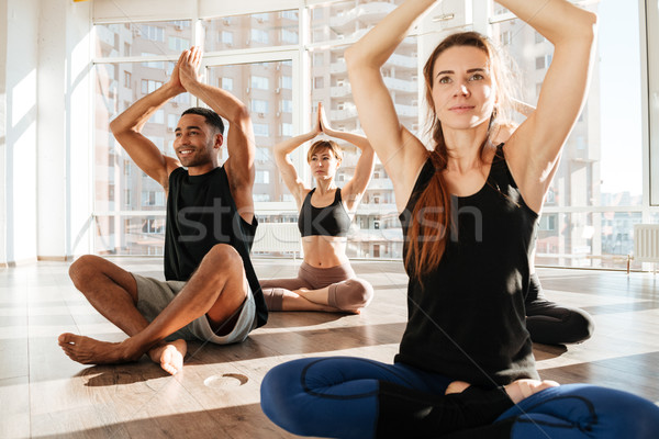 Groep mensen mediteren lotus pose yoga studio Stockfoto © deandrobot