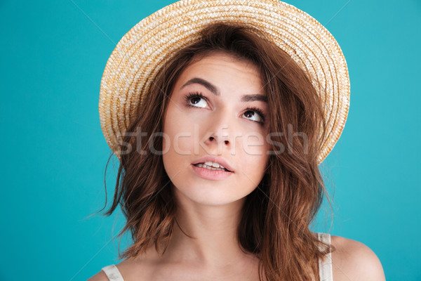 Thoughtful young woman in straw hat wondering and looking away Stock photo © deandrobot
