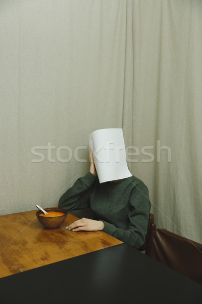Vertical image of woman hiding behind piece paper Stock photo © deandrobot