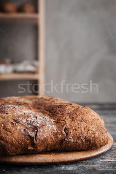 Ekmek un fotoğraf karanlık ahşap masa fırın Stok fotoğraf © deandrobot