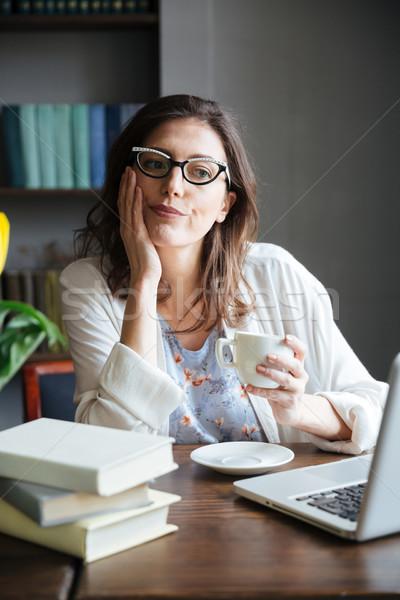 Nudzić starsza kobieta okulary kubek herbaty Zdjęcia stock © deandrobot
