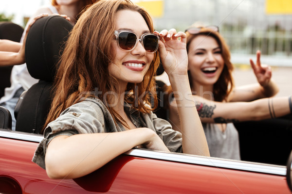 Two smiling happy girls in sunglasses having fun ride Stock photo © deandrobot