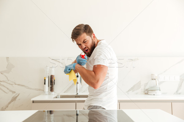 Funny bearded man playing with cleaners Stock photo © deandrobot
