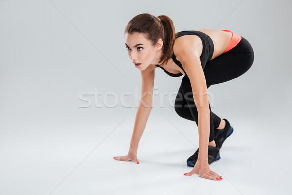 Koncentrált fitnessz nő fut stúdió szürke sport Stock fotó © deandrobot