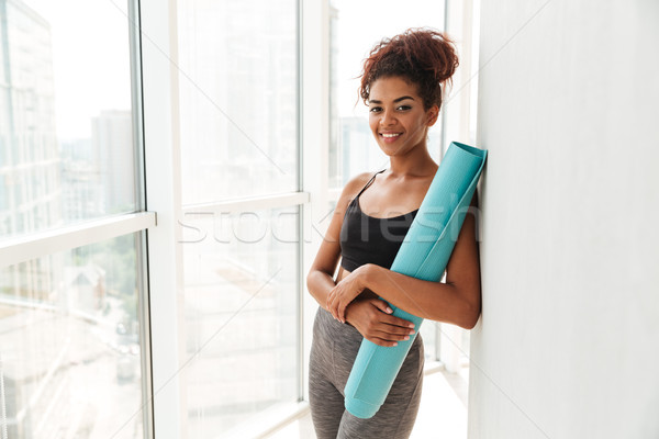 Happy fitness woman looking camera and smilng Stock photo © deandrobot