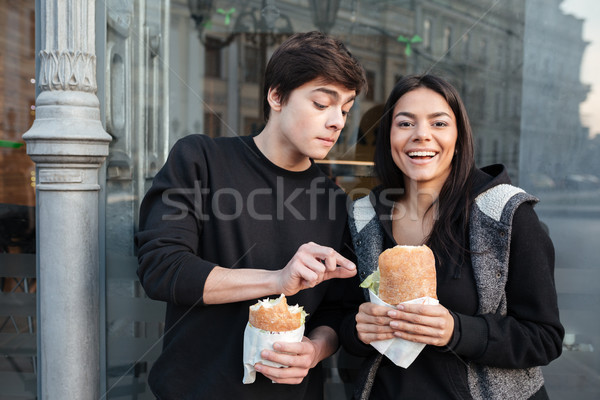 Brother trying to eat burger Stock photo © deandrobot