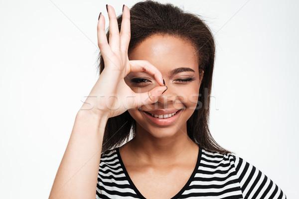 Gelukkig jonge afrikaanse dame tonen okay Stockfoto © deandrobot
