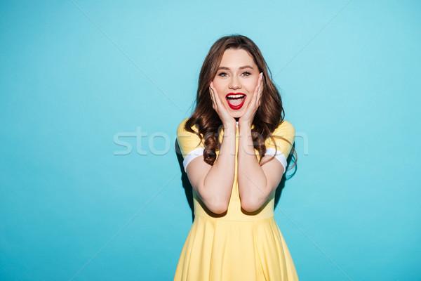 Szczęśliwy podniecony kobieta sukienka otwarte usta Zdjęcia stock © deandrobot