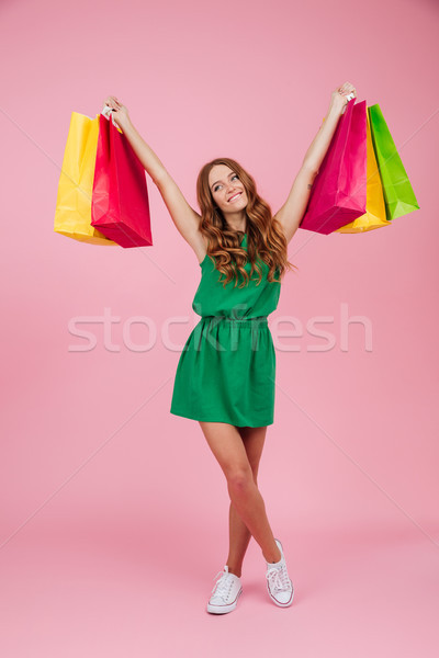 Full length portrait of a woman in dress looking away Stock photo © deandrobot