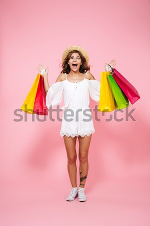 Full length portrait of a happy satisfied woman Stock photo © deandrobot