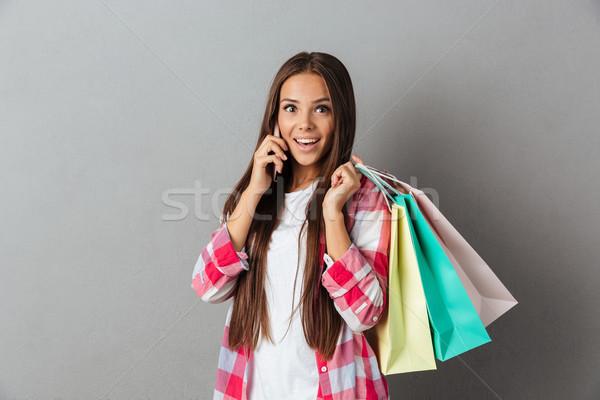 Photo heureux excité incroyable jeune femme regarder Photo stock © deandrobot