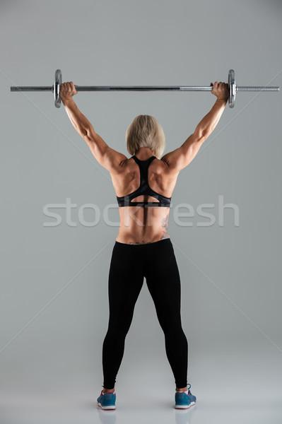 Vista posterior muscular adulto pie Foto stock © deandrobot