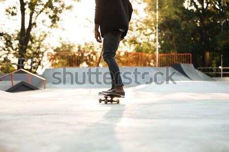 Kép fiatal férfi tinédzser lovaglás gördeszka Stock fotó © deandrobot