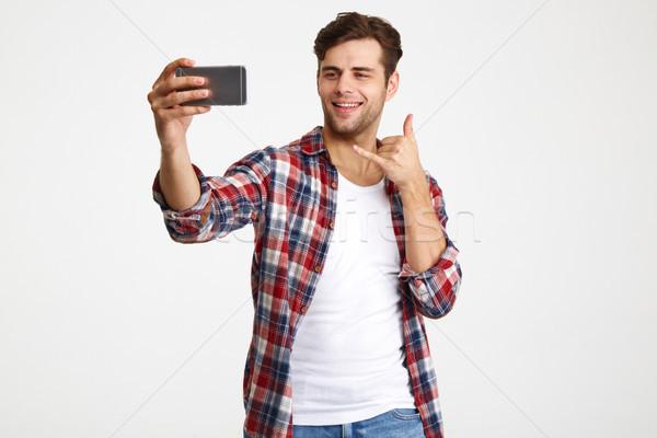 Portret uśmiechnięty funky człowiek stałego Zdjęcia stock © deandrobot