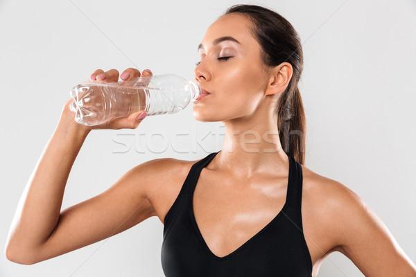 Zdumiewający piękna młodych sportowe pani woda pitna Zdjęcia stock © deandrobot