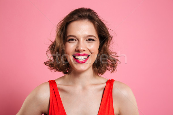 Close up portrait of a smiling cheerful woman Stock photo © deandrobot