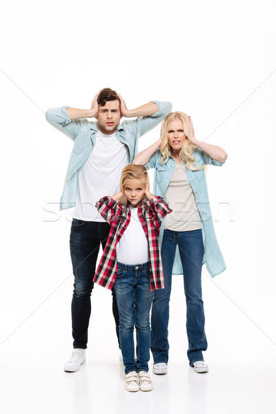 Full length portrait of an irritated upset family Stock photo © deandrobot