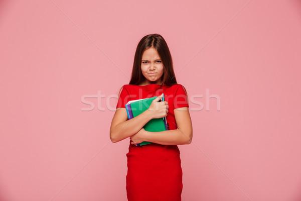 Boldogtalan elégedetlen lány vörös ruha tart könyv Stock fotó © deandrobot