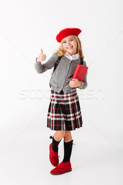 Full length portrait of a cheery little schoolgirl Stock photo © deandrobot
