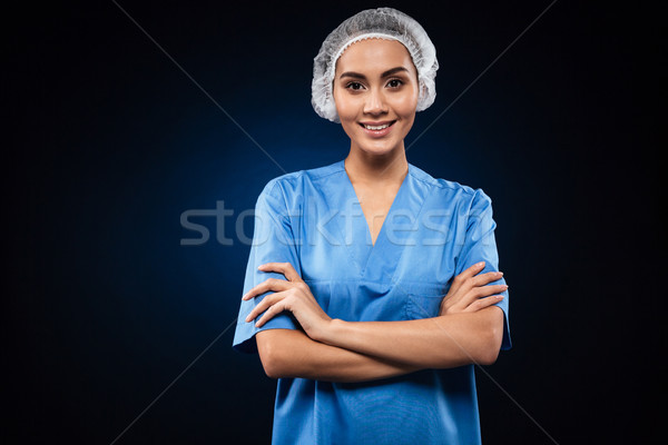Cheerful female doctor looking camera and smiling isolated Stock photo © deandrobot