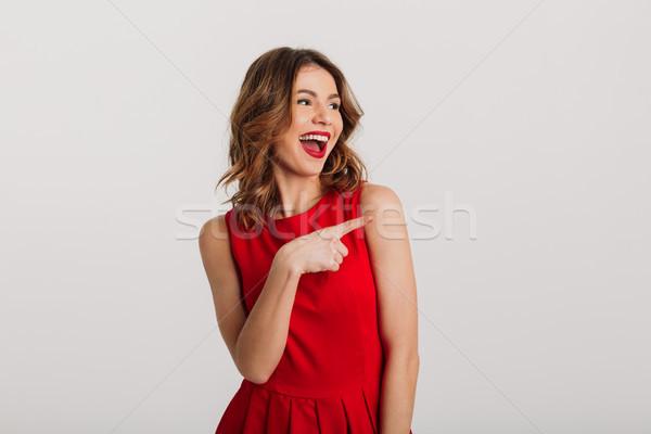 肖像 楽しい 若い女性 赤いドレス ポインティング 指 ストックフォト © deandrobot