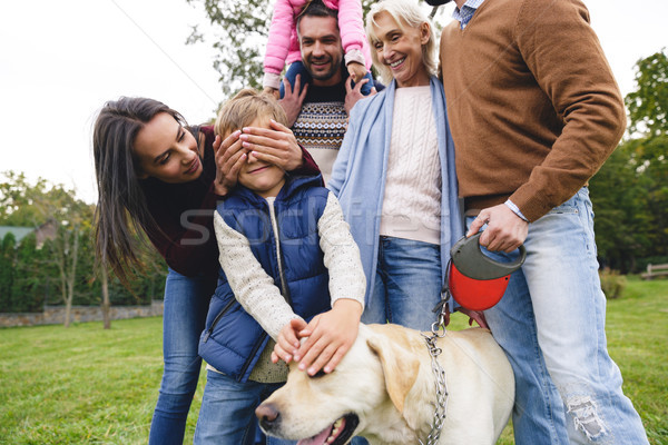 Big positive family with labrador dog spending time together Stock photo © deandrobot
