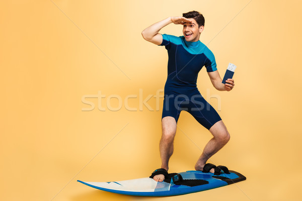 Full length portrait of an excited young man Stock photo © deandrobot