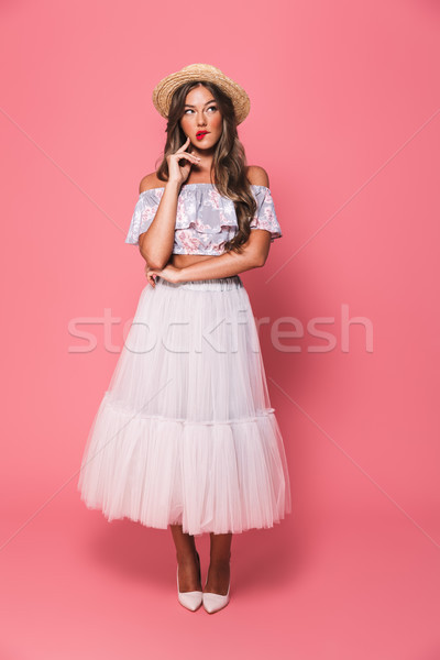 Full length portrait of brunette surprised woman 20s wearing str Stock photo © deandrobot