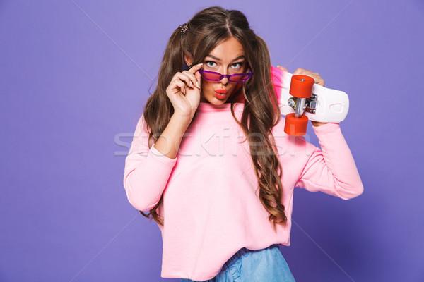 Porträt positive Mädchen Sweatshirt posiert Skateboard Stock foto © deandrobot