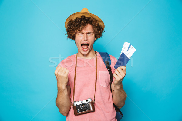 Image of photographer man 18-20 with curly hair wearing backpack Stock photo © deandrobot