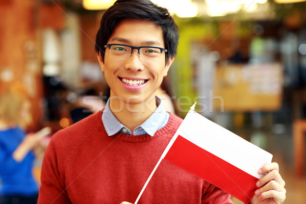 Smiling asian boy in glasses holding flag of Poland Stock photo © deandrobot