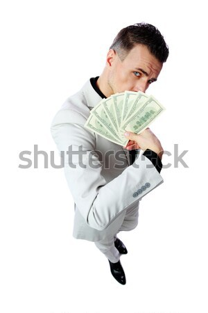 Confident businessman holding US dollars isolated on a white background Stock photo © deandrobot